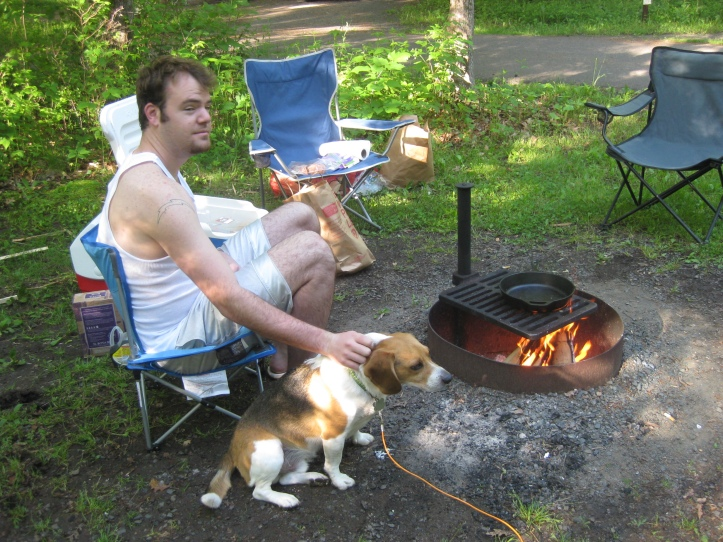 Ryan and Roscoe the beagle cook breakfast by campfire.