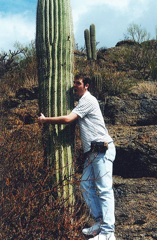 Me posing with my first cactus... look at that fancy camera pouch.