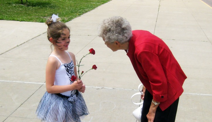 Peyton is congratulated by Grandma Bell after her ballet recital.