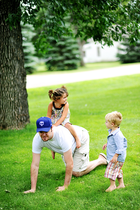Emerson Krogman and Hudson Krogman play with Uncle Ryan