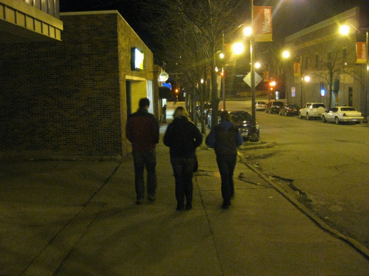 IOWA: Lauren and her brother and sister walk down the street of Ames at night.