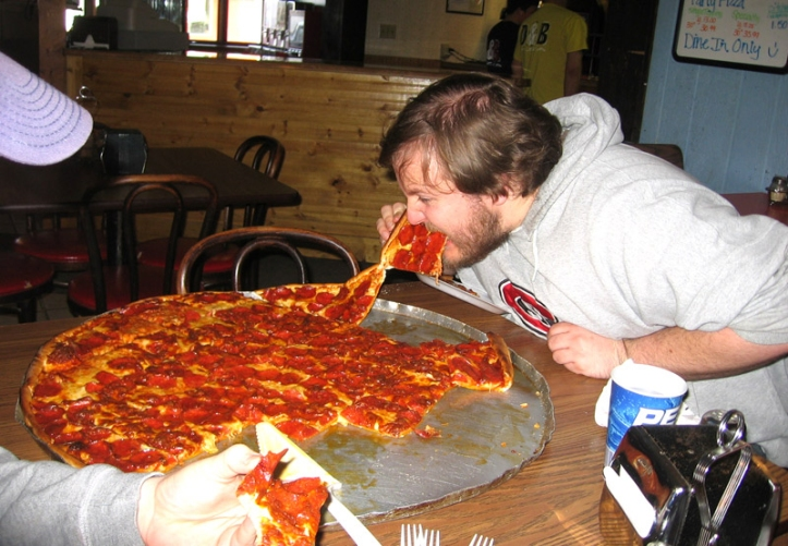 NORTH DAKOTA: Jason works on the giant pizza from D&B's in Rolla