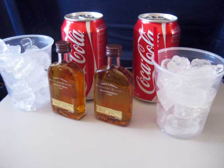Drinking whiskey Cokes on the airplane