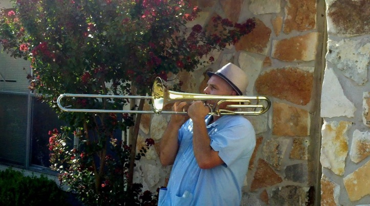 Mark Addison playing trombone at garage sale