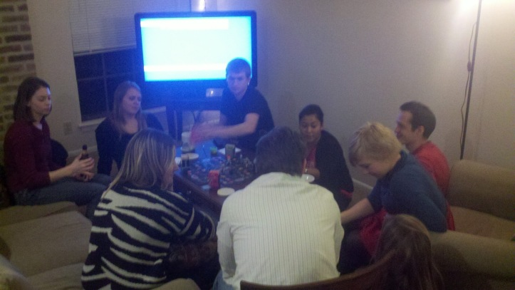 Friends gathering at our board game party Saturday night