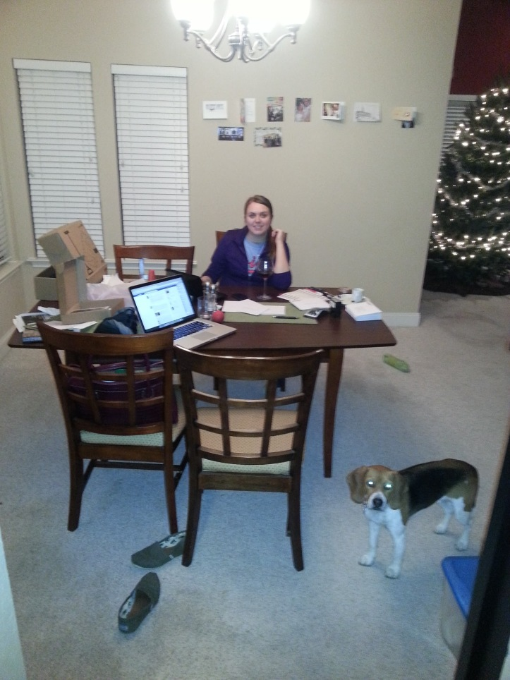 Lauren and Baxter address Christmas cards while listening to Christmas carols near the Christmas tree in preparation for Christmas.
