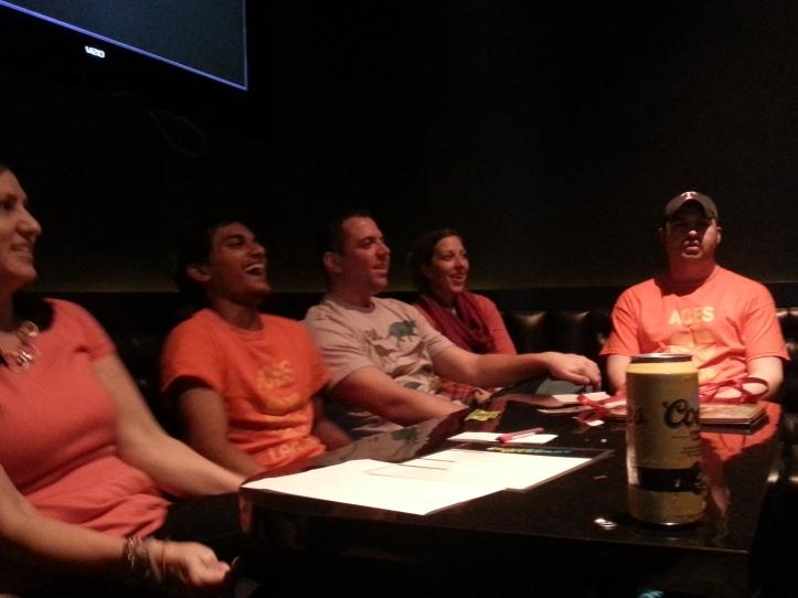 The karaoke gang looks on at an amusing performance.