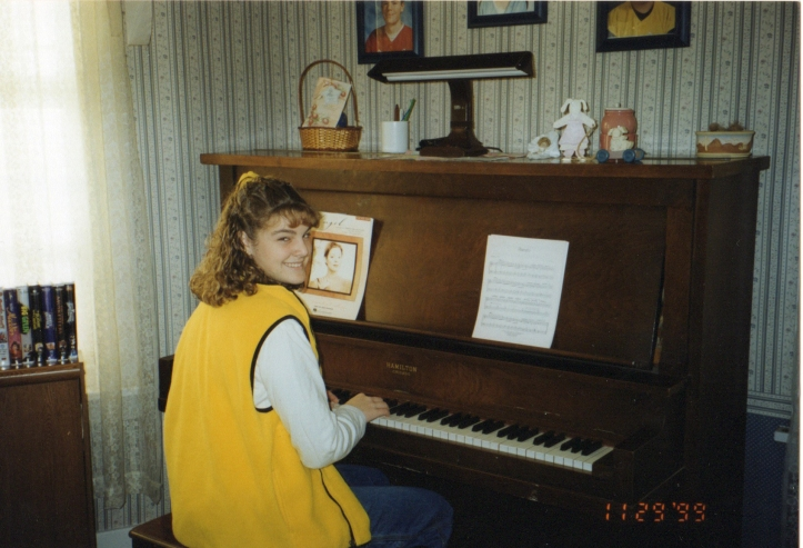 Jordan happily playing piano.