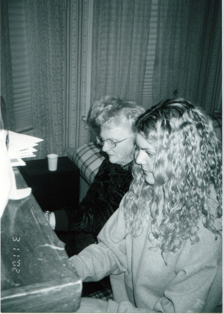 Jordan and Granny playing piano.