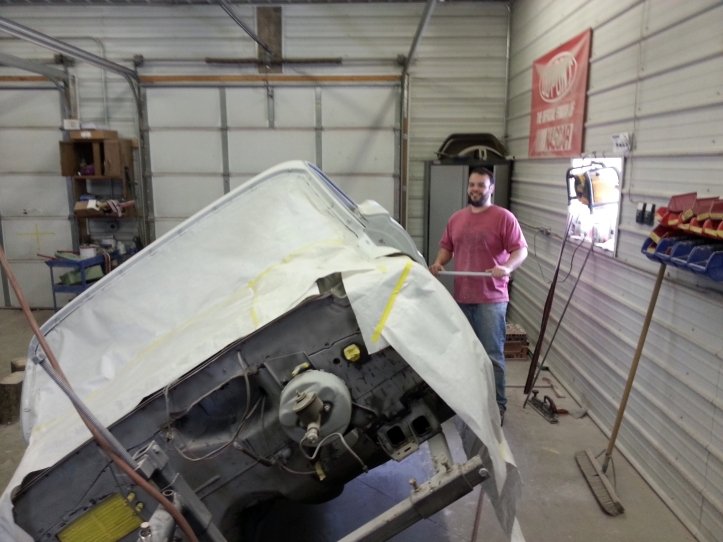 Brother Alex hard at work restoring a car in his shop.