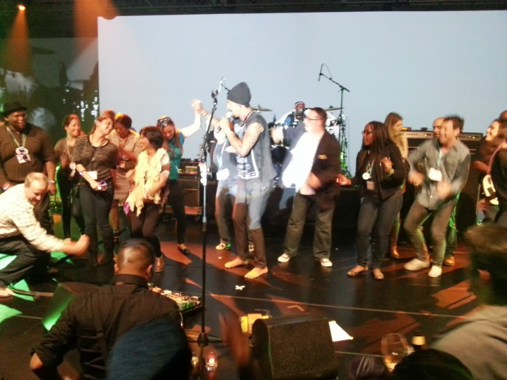 The private Michael Franti concert. Shenea is up on stage with him.