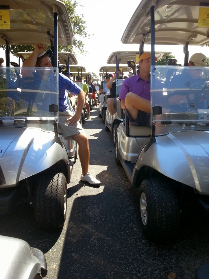 The teams lined up in their carts for the start of the tournament.