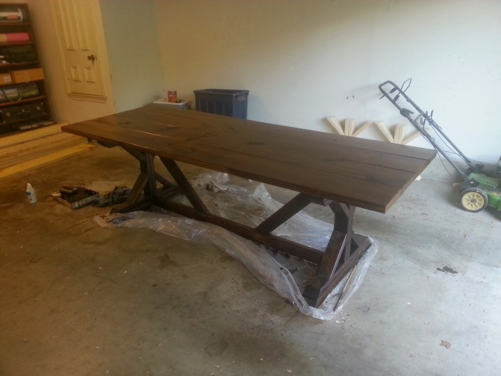 The table top carefully turned over and placed on its base, then stained.