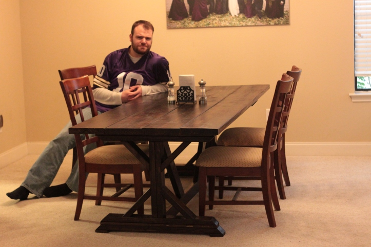 Me at my finished farmhouse table. A+ for effort! We'll see how she holds up in the long run.