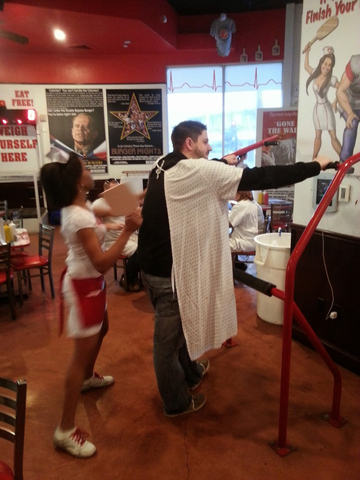 Jay getting spanked by the nurse waitress at Heart Attack Grill for not finishing his absurdly high-calorie food.