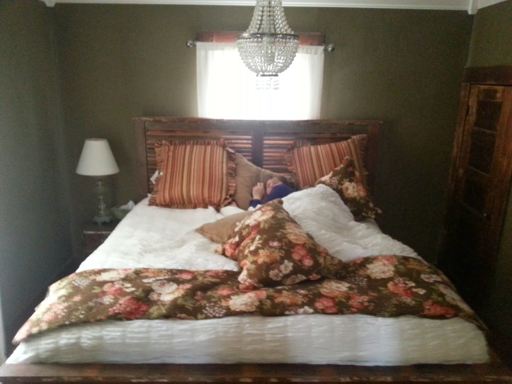 Lauren buried under the pillows in our comfy B&B bed in Fredericksburg.