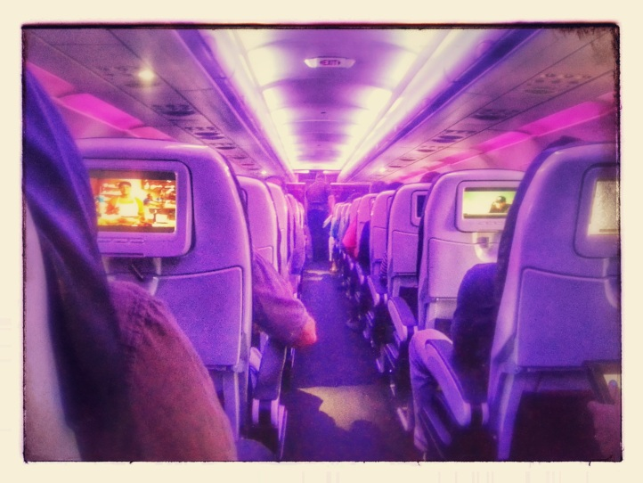 We flew Virgin America for the first time and it was super cool! I had free access to on-demand movies and TV shows (actual good ones) and could order food and drink at the touch of the screen. Plus the purplish tint was cool.