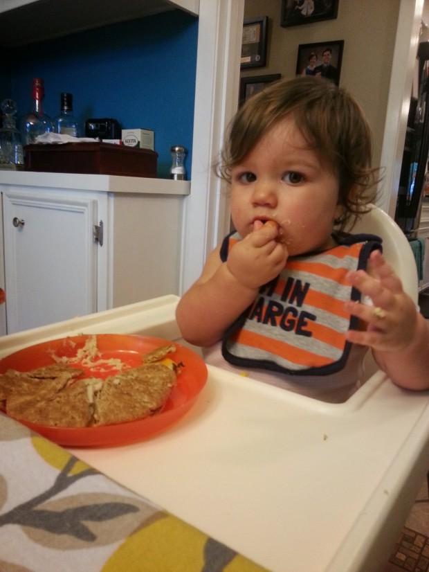 The Megos had us over for dinner on Sunday night. Here's our fairy-goddaughter Lexi enjoying her dinner.
