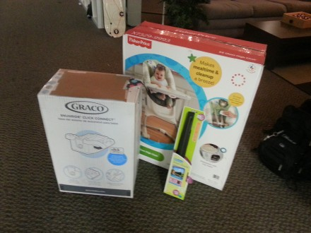 My Callaway co-workers pooled money together and bought us some baby gifts! We now have a high chair, a second car-seat base, and a car window shade. Nice gesture by the CGI team!