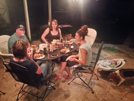 The family is welcomed back to Austin with a meal hot off the grill.