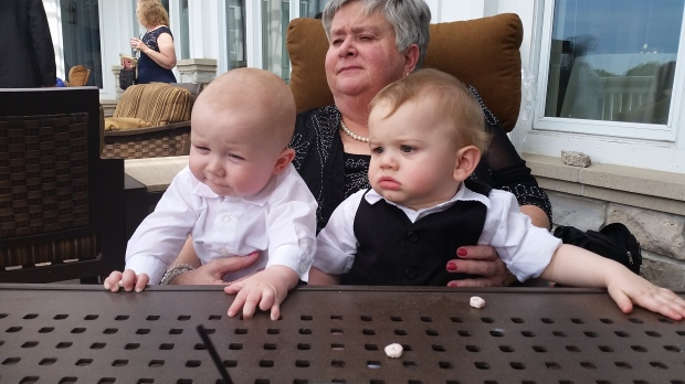 Great-aunt Alice hangs with Theo and John at the reception.