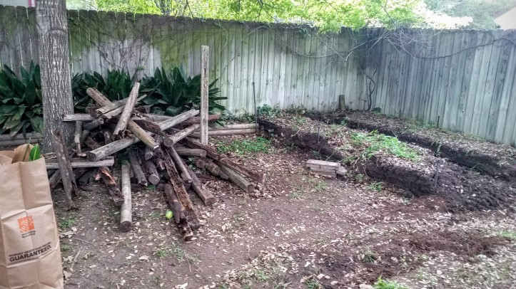 I threw all the rotted wood planks and stakes into a pile... TBD what I'll do to dispose of this within city limits.