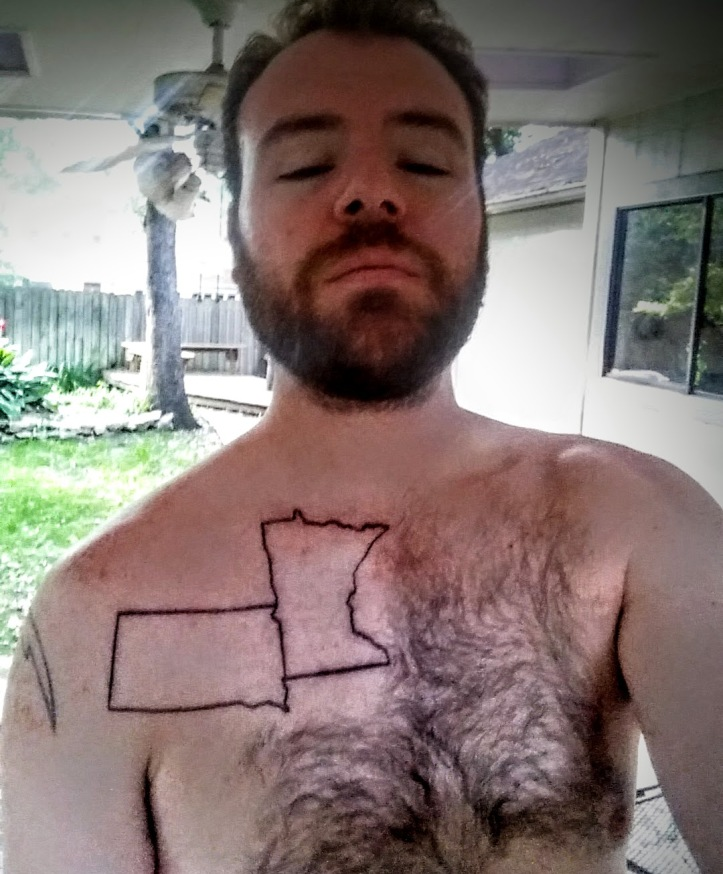 The fresh new tattoo in the shaved area of my chest.